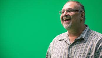 Man with green screen in the background
