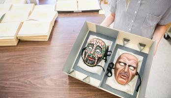 Two Irene Corey theater masks at ASU Library