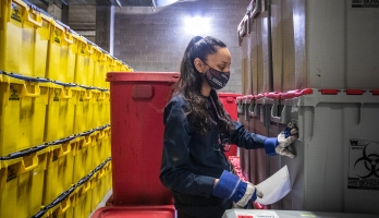 Woman inspecting biowaste