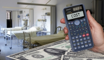 image of hospital with money in foreground