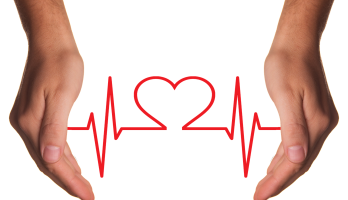 abstract image of vital sign indicator line with a heart between two hands