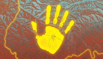 yellow handprint against backdrop of mountain topography