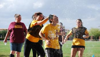 students having a water balloon fight
