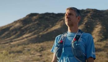 man in running gear in desert