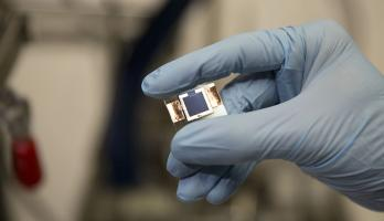 A perovskite/silicon tandem solar cell, created by research teams from Arizona State University and Stanford University, capable of record-breaking sunlight-to-electricity conversion efficiency. Photographer: Pete Zrioka/ASU
