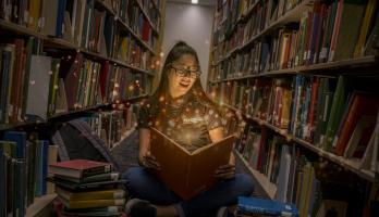 Girl in a library amazed by books