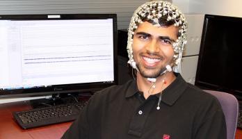 student wearing EEG cap