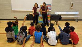 ASU nursing students answer questions at a health fair they organized