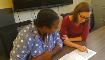 ASU student researchers Taija Hendrix and Emily Webb look at survey results