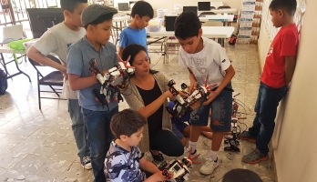 Victoria Serrano shows robots to young students