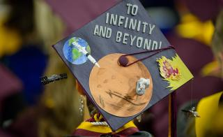 """graduation cap that says """"To infinity and beyond"""""""