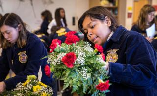 Jessica Vasquez arranges flowers at FFA conference