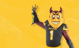 Sparky in a black ASU jersey, holding up a pitchfork