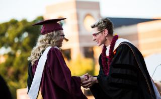 Dean Marlene Tromp and a student at the New College convocation