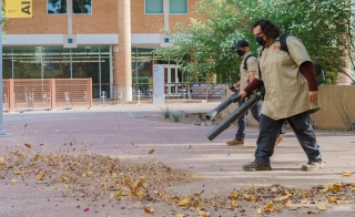 ASU grounds crew blowing leaves