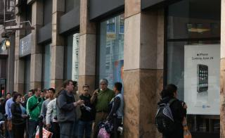 people standing in line in front of AT&T building