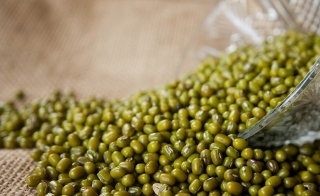 mung beans being poured out of a bowl
