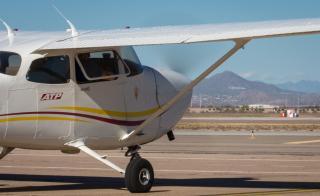 A plane sits on a desert runway.