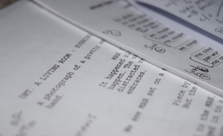close-up photo of a screenplay typed on paper