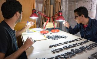 Scholars look at obsidian knife points at ASU's Teotihuacan Research Laboratory in Mexico