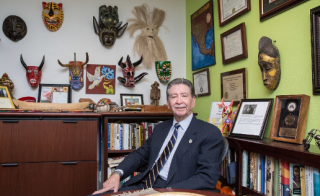 ASU Regents Professor Carlos Velez-Ibanez in his office
