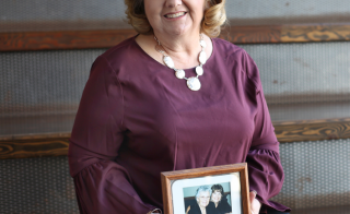 A senior program coordinator on ASU's Polytechnic Campus, Carolyn Starr displays a photo of her mother who she was able to visit with the help of the Staff Helping Staff Fund.