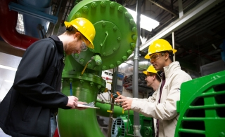 two people in mechanical plant