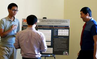 Congy Li and Qilun Li discuss their research results at an undergraduate research symposium sponsored by the College of Public Service and Community Solutions.