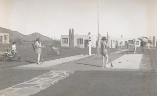 Women playing shuffleboard.