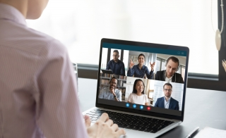 Person particiaptes in video conferencing