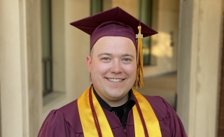 Dustin Vang stands with his ASU cap and gown on