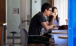 Students study intently at the ECG Student Center on the Arizona State University Tempe campus.