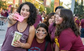 family taking a selfie during family weekend at ASU