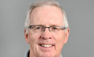 A photo of ASU research professor Francis P. McManamon