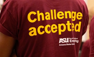 "A student in the Grand Challenges Scholars Program at ASU wears a t-shirt that says ""Challenge Accepted."""