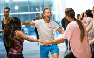 Students laugh during a Herberger Institute Day dance workshop