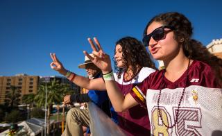 Fans cheer during the ASU Homecoming Parade.