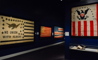 Photo shows four different American flags from different points in history