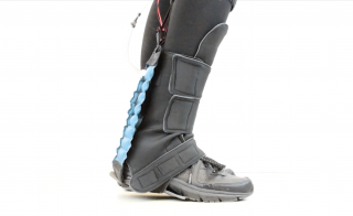 soft robotic exosuit on a lower leg and foot
