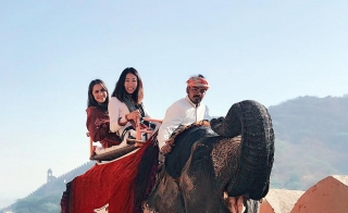 ASU students riding an elephant on their study abroad trip to India