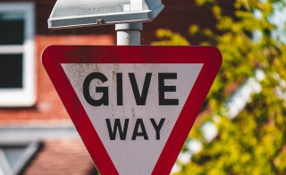 Give Way street sign