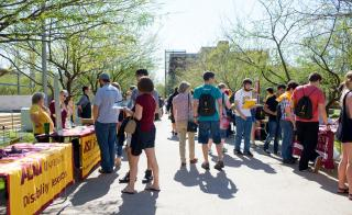 students visiting booths at ASU fair