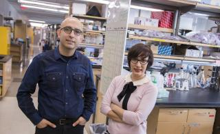 ASU assistant professors Samira Kiani and Mo Ebrahimkhani pose side by side in Dr. Kiani's lab