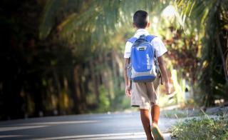 Boy walking to school