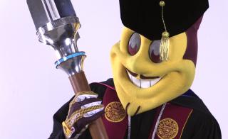 Sparky holding university mace