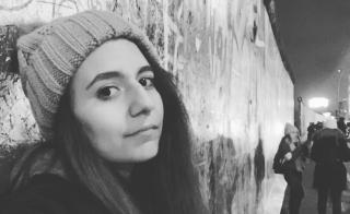 Photo of Tasha Romero at the Berlin Wall