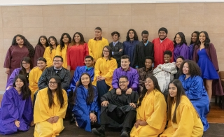 TRIO Upward Bound students pose in their graduation gowns in a spring 2019 celebration at ASU in Tempe