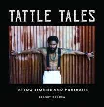 man posing on book cover in tattoos