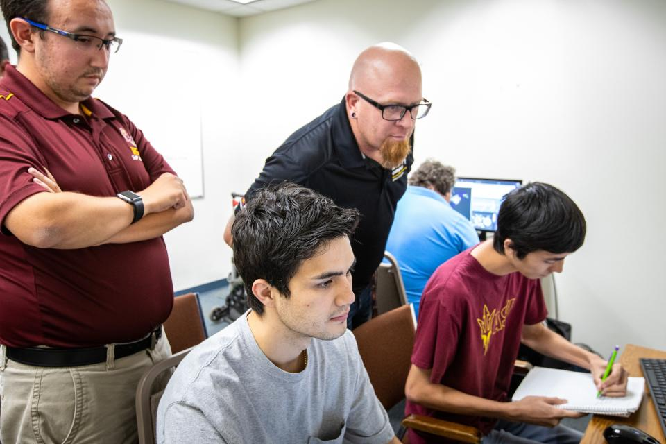 Drone-pilot students work on a class mission