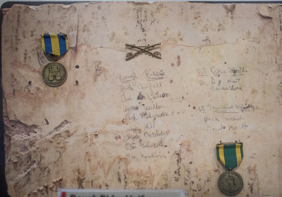 Salvaged piece of wall includes names of six of the seven members of volunteer group of cavalry in the Spanish-American War who attended Tempe Normal School